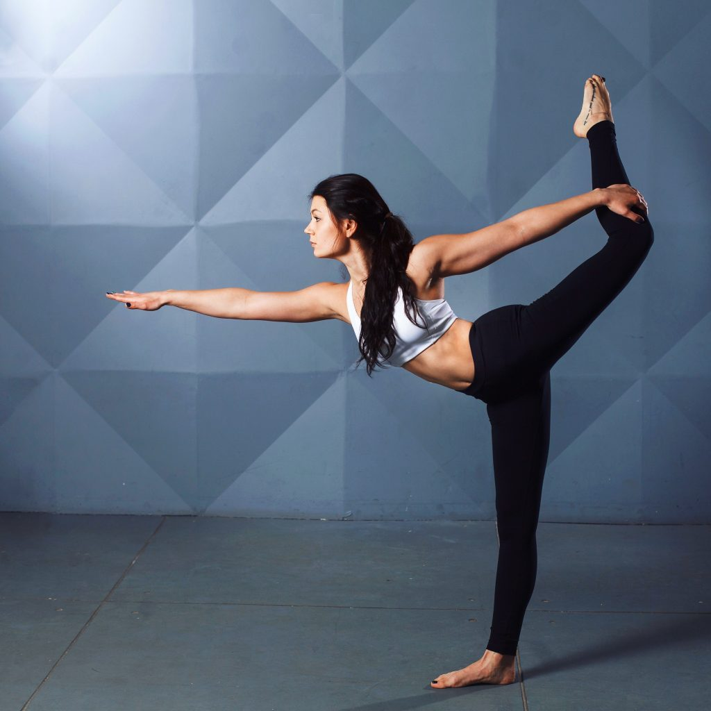 Girl in Yoga post with blue background