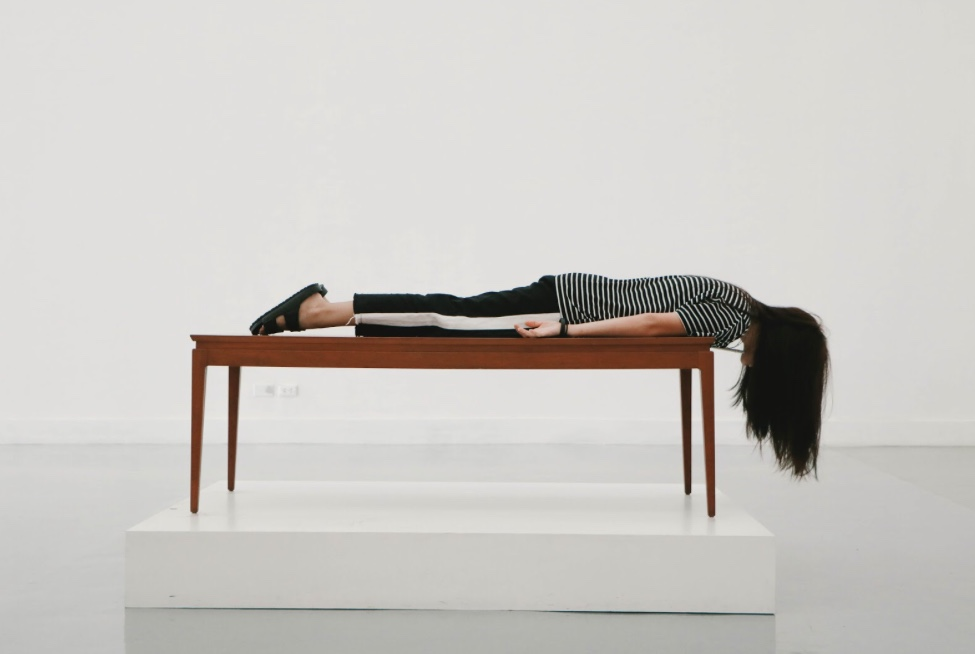 girl laying flat on table