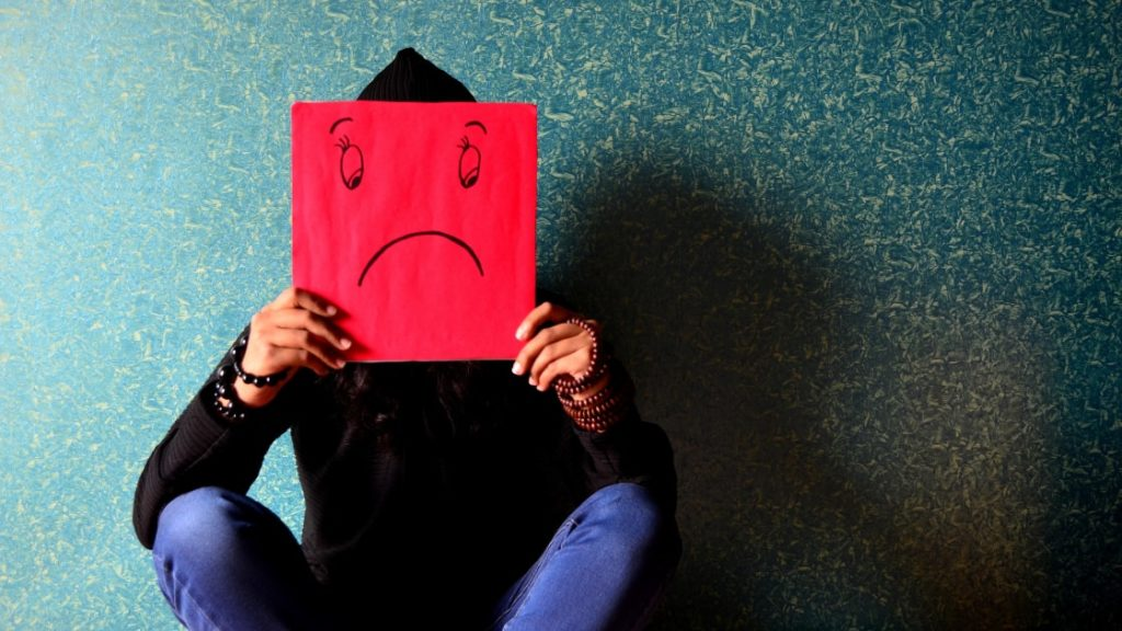 emotional stress impacts on girl holding sad face