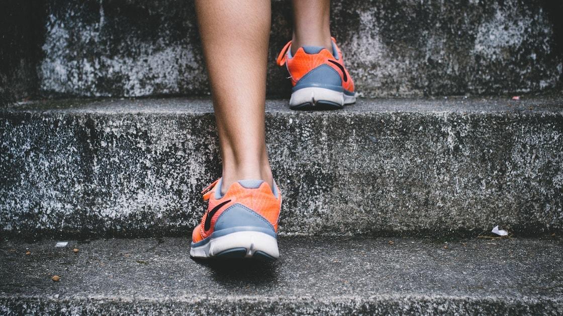 Orange shoes walking up stairs