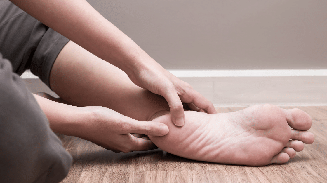 Person with heel pain because of plantar fasciitis