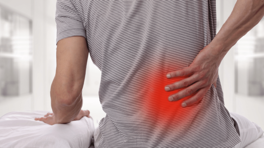 treating back pain because guy is grabbing lower back in pain