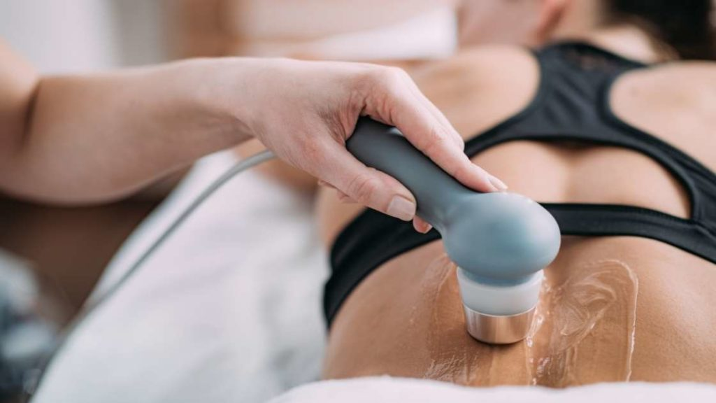 woman receiving ultrasound therapy treatment on her back