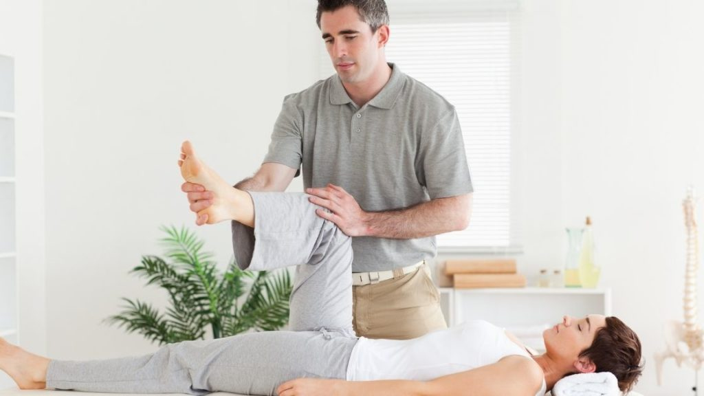male trainer performing pnf stretching