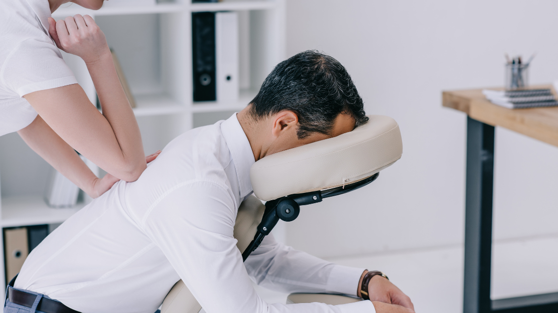 man receiving corporate chair massage