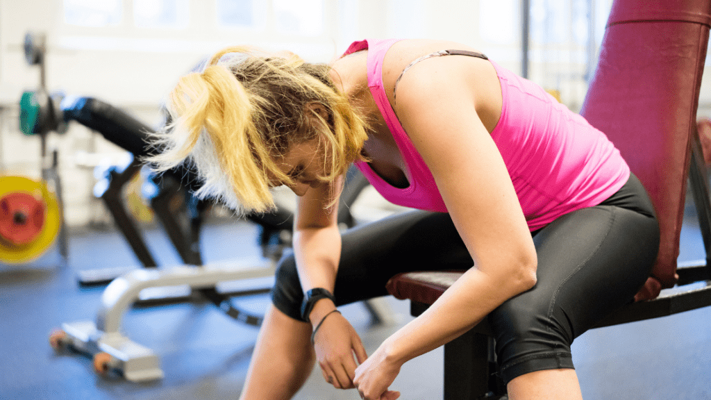 woman bent over a bench starting slowly in her workout
