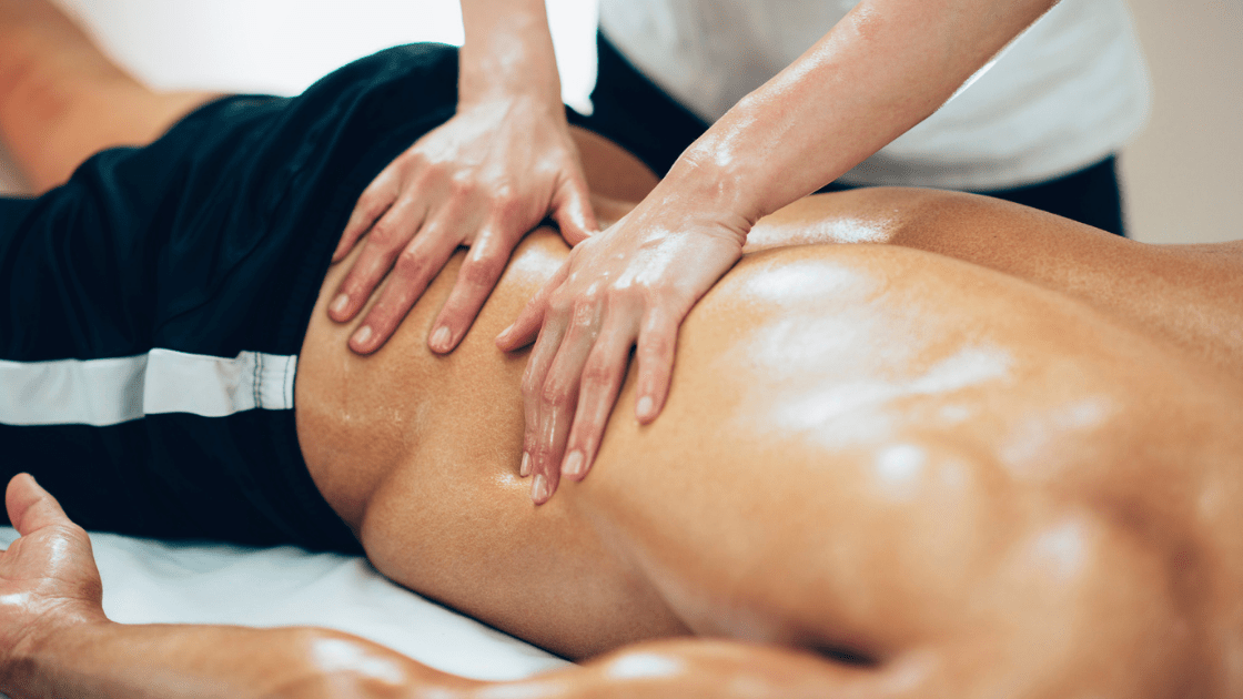 man receiving rolfing for chronic pain in back