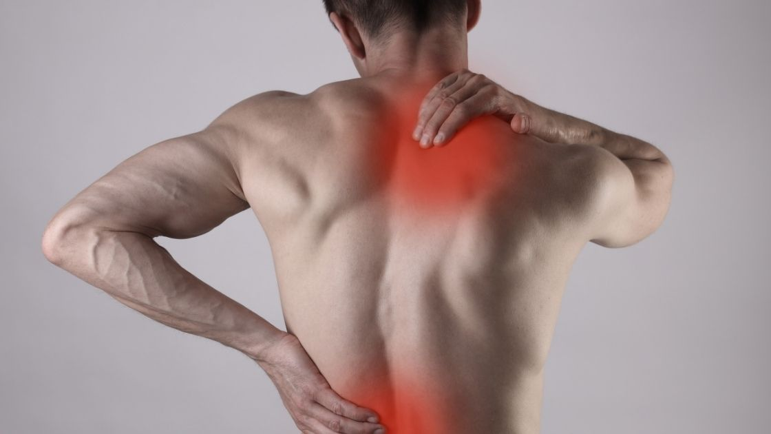 man grabbing back with muscular pain