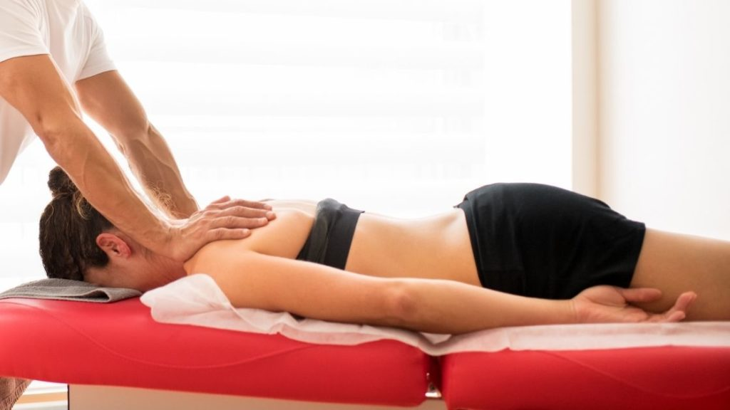 woman laying on massage table ready for a myofascial release session