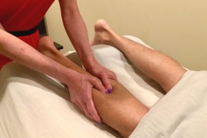 Myofascial Release Therapy on a person's leg