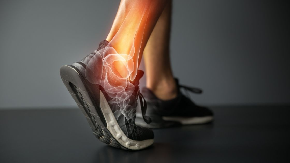 person with ankle joint pain